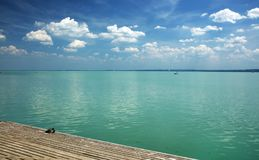 Balaton Lake seen from Balatonfured shore. Lake Balaton  is a freshwater lake in Transdanubian region of Hungary. It is the largest lake in Central Europe, and Royalty Free Stock Image