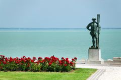 The ferryman statue. Balaton Lake seen from Balatonfured shore. Lake Balaton  is a freshwater lake in Transdanubian region of Hungary. It is the largest lake in Royalty Free Stock Photos