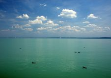 Balaton Lake seen from Balatonfured shore. Lake Balaton  is a freshwater lake in Transdanubian region of Hungary. It is the largest lake in Central Europe, and Royalty Free Stock Photography