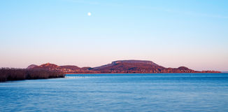 Lake Balaton in sunset with moon in autumn Royalty Free Stock Images