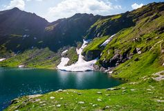 Lake Balea in Fagaras mountains on a bright sunny. Day. amazing summer landscape of one of the most visited landmarks in Romania Royalty Free Stock Photography