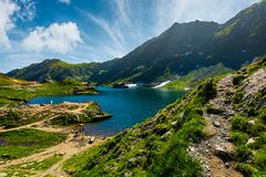 Lake Balea in Fagaras mountains on a bright sunny. Day. amazing summer landscape of one of the most visited landmarks in Romania Royalty Free Stock Image