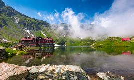 Lake Balea in Fagaras mountains in foggy weather. Transfagarasan road, Romania - Jun 26, 2017: lake Balea in Fagaras mountains in foggy weather. amazing summer royalty free stock image
