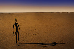 Lake Ballard Statue. A statue of a tribal member stands alone on Lake Ballard. The giant salt lake is located near the gold mining town of Kalgoorlie, Western Royalty Free Stock Photography