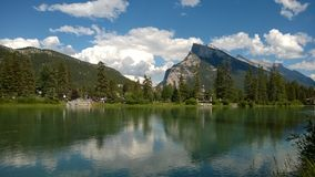 Lake in Banff Park, Alberta, Canada. Mountains reflected in lake in Banff Park, Alberta, Canada with blue skies Royalty Free Stock Photo