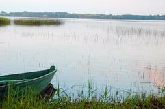 Lake bank. Boat on lake bank Royalty Free Stock Photo