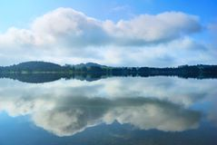 Lake banks and clouds reflection Stock Photo