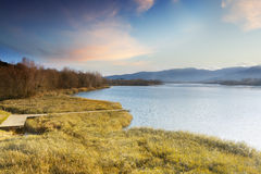 Lake Banyoles with wooden pier Stock Photo