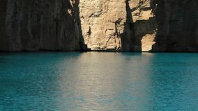 Lake basin sunlight reflecting on travertine rock walls. Band-e Amir Lakes. Band-e Amir National Park, Bamyan Province, Afghanistan. Mid shot stock video footage