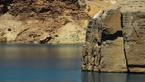 Lake basin with travertine cliffs. Band-e Amir Lakes. Band-e Amir National Park, Bamyan Province, Afghanistan. Mid shot stock footage