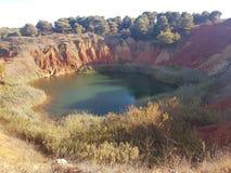Lake of bauxite quarry Stock Photo