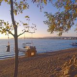 Lake beach autumn sunrise. Sandy lake beach in autumn at sunrise royalty free stock photos