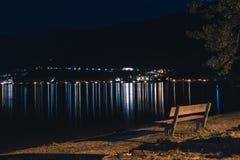 Free Lake Beach Bench By Sidewalk At Night Illuminated With Street Lantern. Zell Am See Austria Stock Photos - 163472933