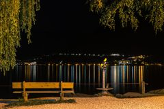 Free Lake Beach Bench By Sidewalk At Night Illuminated With Street Lantern. Zell Am See Austria Stock Image - 163473031