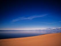 Lake beach morning sky clouds Royalty Free Stock Image