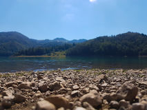 Lake beach. Stone beach on a Zaovine lake Royalty Free Stock Photography