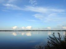 Lake and beautiful cloudy sky Stock Image