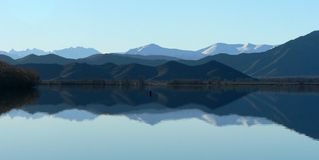 Lake Benmore Mirroring, South Island, New Zealand Royalty Free Stock Photography
