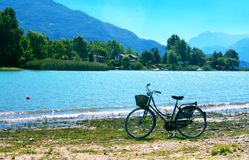 Lake with bike. Lake landscape with trees and mountains Stock Image