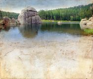 Lake in the Black Hills on Grunge Background Royalty Free Stock Photo