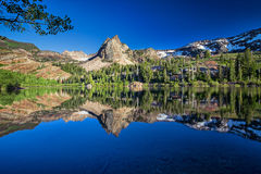 Lake Blanche with tree. This photo was taken at Lake Blanche in Utah at sunset Stock Photo