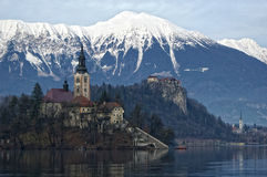 Lake Bled Slovenia. Small island on the lake Bled with a church on it. We can see the Bled castle in the background Royalty Free Stock Photo