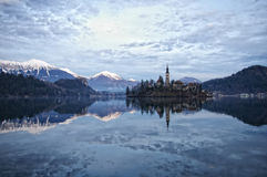 Lake Bled. With an island. On the left we can see the Bled castle and some mountains in the background royalty free stock photo