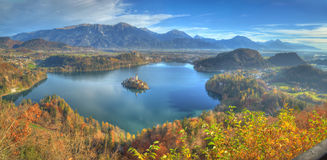 Lake Bled. An amazing autumn photo with Island Bled and church Assumption of the Virgin Mary which reflected in the water of the lake. The view was taken from stock images