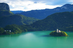 Lake Bled and  Assumption of Mary church. Lake Bled in Slovenia and the  Assumption of Mary church (Cerkev Marijinega vnebovzetja) on Bled Island (Blejski took Stock Photos