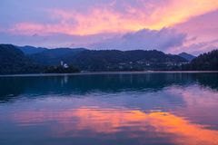Lake bled. With a beautiful island in the middle of the lake at sunset Royalty Free Stock Photos