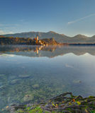 Lake Bled, castle Bled and church   Assumption of the Virgin Mary - morning autumn picture Stock Images