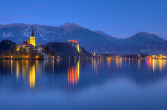 Lake Bled, castle Bled and church   Assumption of the Virgin Mary -  picture during the blue hour  Royalty Free Stock Photos