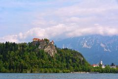 Lake Bled with castle in Slovenia. Bled with lake, island, castle and mountains in background stock image