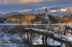 Lake Bled, The Church of the Assumption of the Virgin Mary, Bled Island, Bled castle, Slovenia - winter picture. The Church of the Assumption of the Virgin Mary Royalty Free Stock Photo