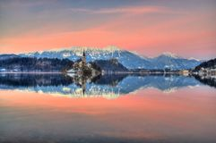 Lake Bled, The Church of the Assumption of the Virgin Mary, Bled Island, Slovenia - sunset in violet Stock Images