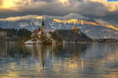 Lake Bled, The Church of the Assumption of the Virgin Mary and Bled castle, Bled Island, Slovenia - winter picture. The Church of the Assumption of the Virgin Stock Photo