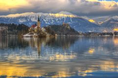 Lake Bled, The Church of the Assumption of the Virgin Mary, Bled Island, Bled castle, Slovenia - winter picture. The Church of the Assumption of the Virgin Mary Royalty Free Stock Images