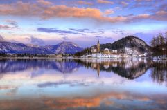 Lake Bled, The Church of the Assumption of the Virgin Mary, Bled Island, Slovenia - sunset in violet Stock Photo