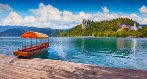 Lake Bled is a glacial lake in the Julian Alps. Lake Bled (Blejsko jezero) is a glacial lake in the Julian Alps in northwestern Slovenia, where it adjoins the Stock Images