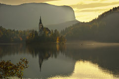Lake Bled, Island Bled and church Assumption of the Virgin Mary , Slovenia - autumn view stock photo