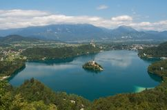 Lake Bled with Island and Castle in Summer. With Karavanke mountain range in the background Stock Image