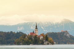 Lake Bled and the island with the church at autumn color. In Slovenia royalty free stock image