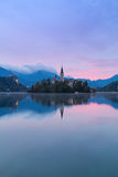 Lake Bled and the island with the church at autumn color at sunr Royalty Free Stock Photo