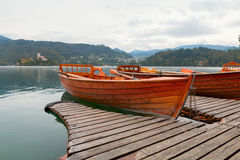 Lake Bled and the island with the church and wooden boats at aut Royalty Free Stock Photo