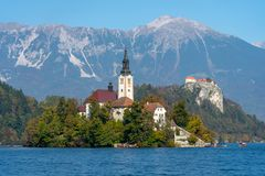 Lake Bled island with mountains in the background royalty free stock photography