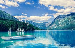Lake with boating, mountains stock photos