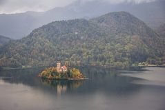 Lake Bled on a rainy day. Autumn view of  the historical church on the island in Lake Bled on a rainy day Stock Images