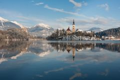Lake Bled, Slovenia. View on lake Bled with small island with church and castle on rock in Slovenia, Europe Royalty Free Stock Photography