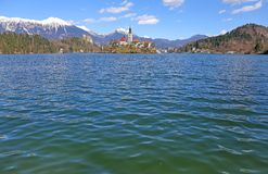 Lake BLED in SLOVENIA Europe. Island of Lake BLED in SLOVENIA Europe and the snowy mountains Royalty Free Stock Photo