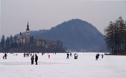 LAKE BLED, SLOVENIA - FEBRUARY 12 2012: Families enjoying a frozen Lake Bled. A winter festival atmosphere on a frozen Bled Lake Royalty Free Stock Image